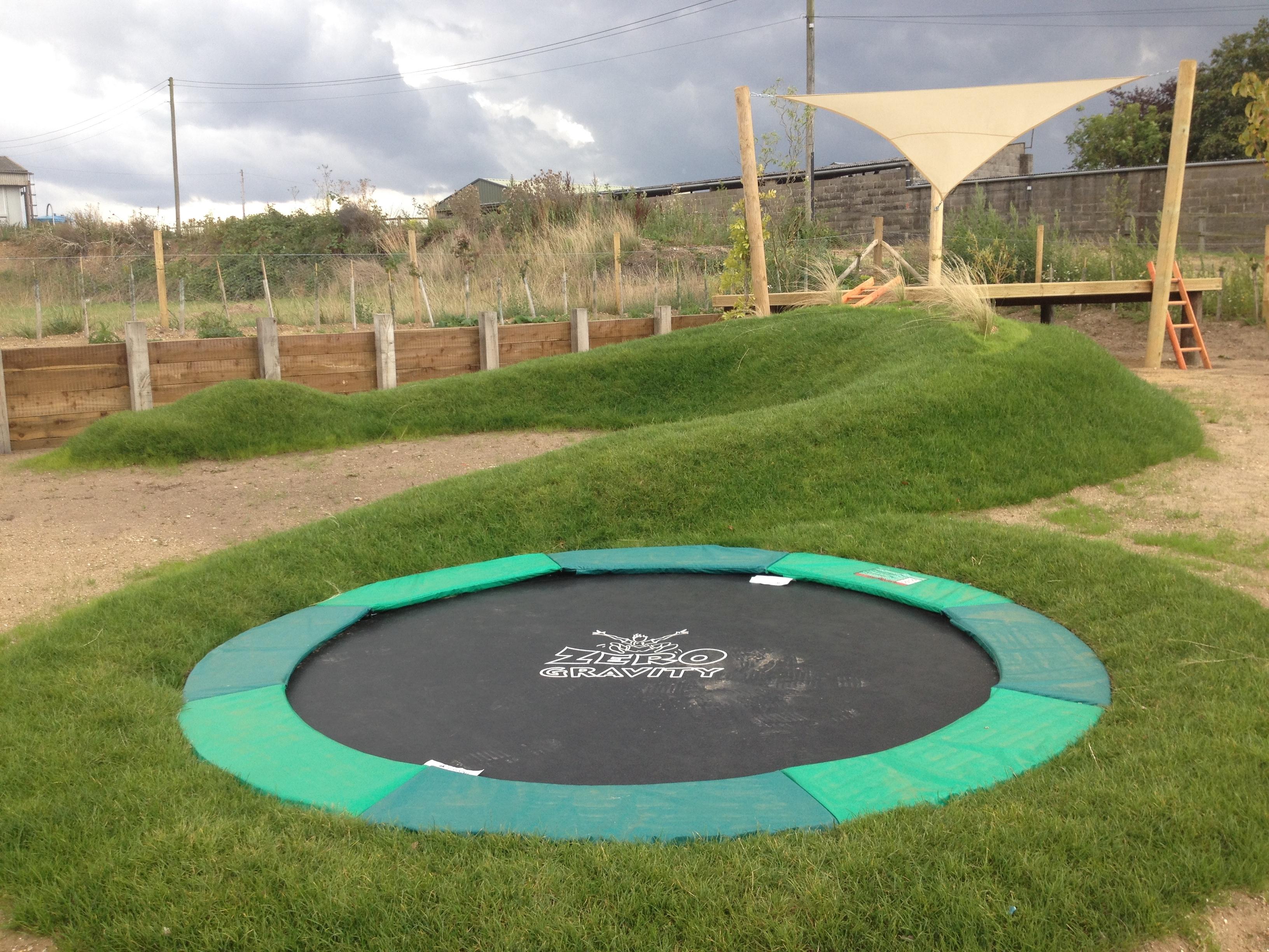 children play garden, grass mound, dinosaur mound, sunken trampoline Kettlestone Norfolk