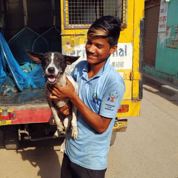 VfA Member Holding a Rescued Dog