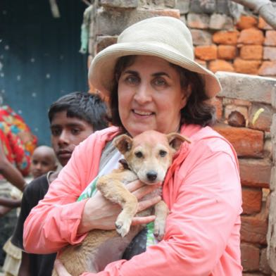 VfA members lovingly patting a rescued dog