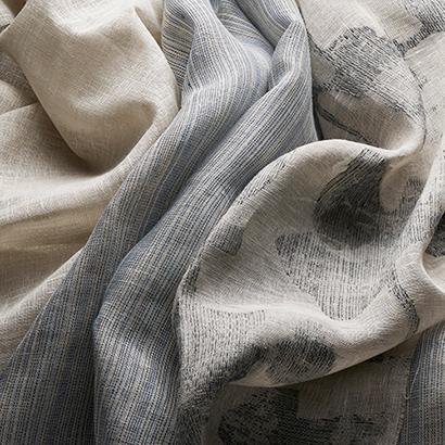 A few linen shading fabrics laid side by side.