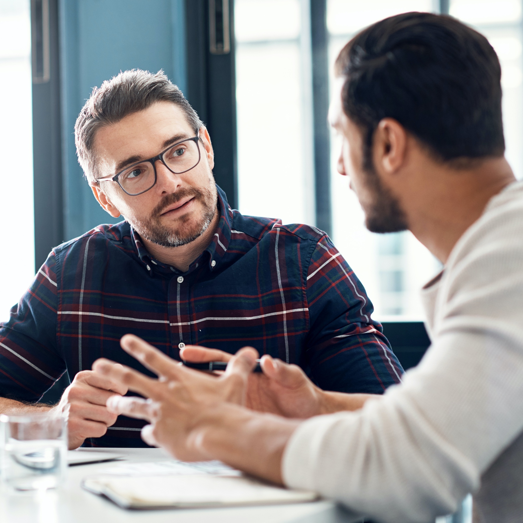 Employer interviewing a potential employee in a conference room.