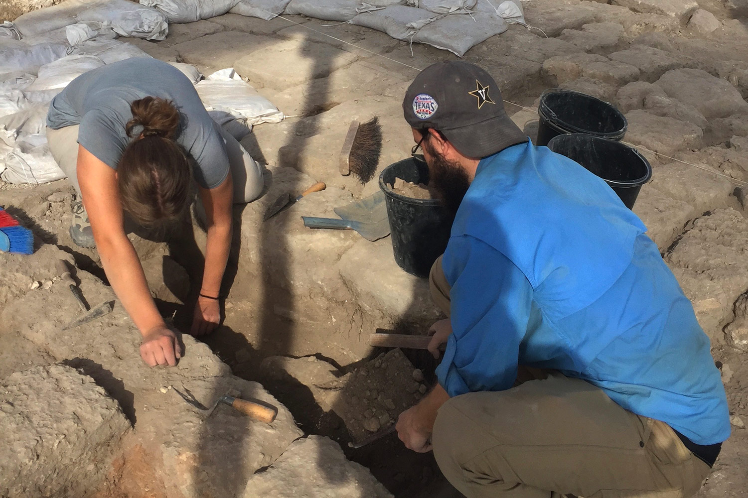 Archaeologists digging at an excavation site