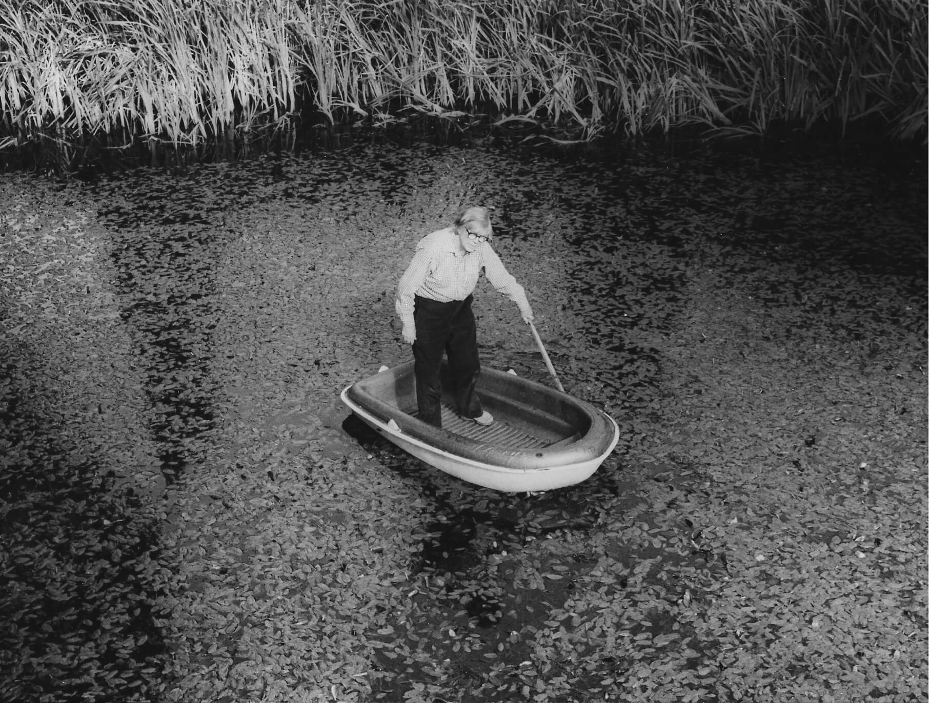 George Rickey standing in boat floating on a pond, Germany, 1987