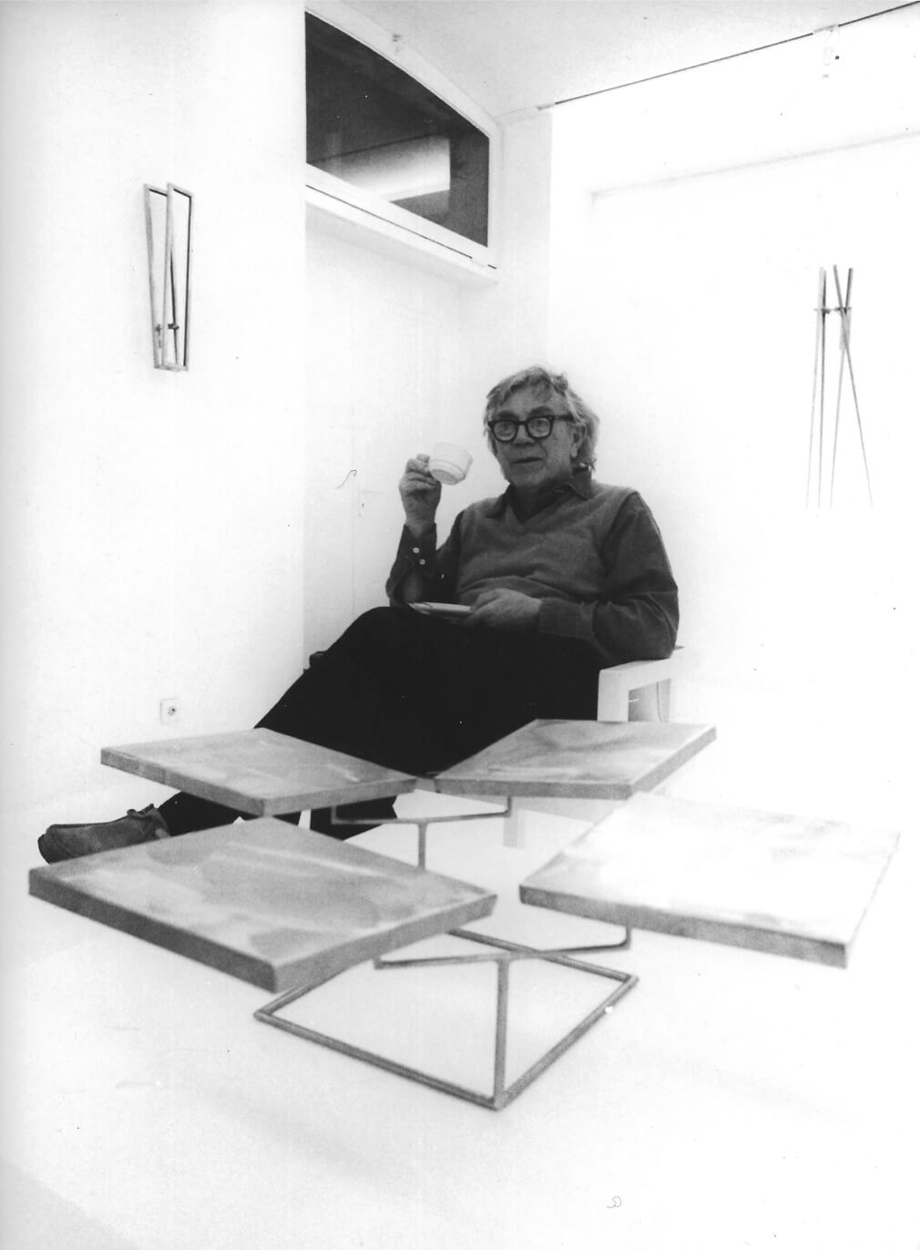 George Rickey sitting with with Five Squares Horizontal (1981) at the Josef Albers Museum, Bottrop, Germany, 1984