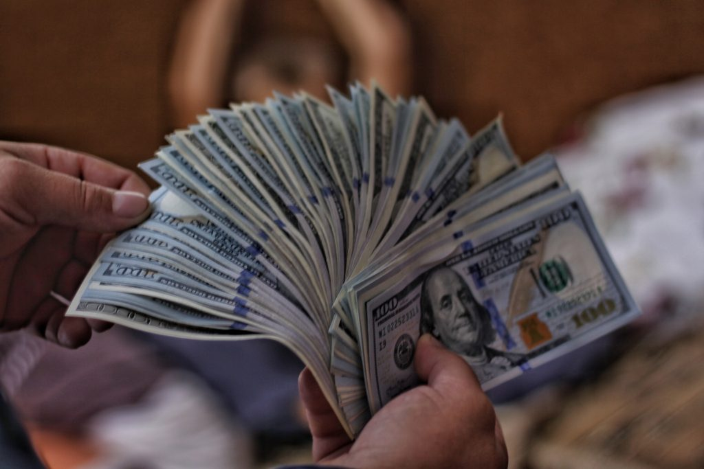 Stacks of cash that dropshipping can help you earn