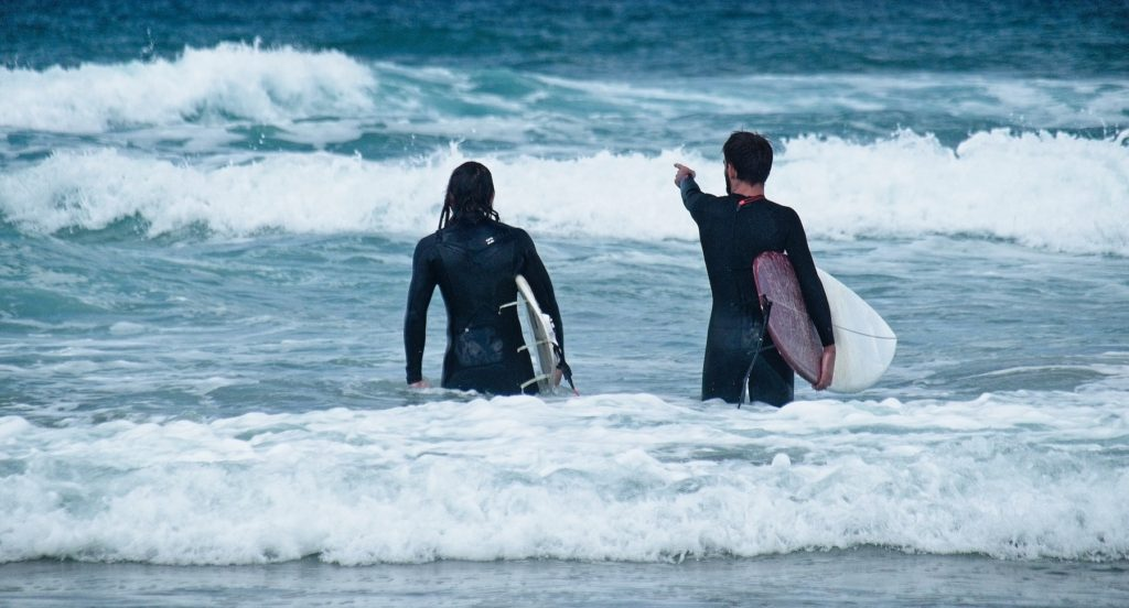 Want to know how to make money while traveling? Become a surf instructor, and you can work with other tourists!