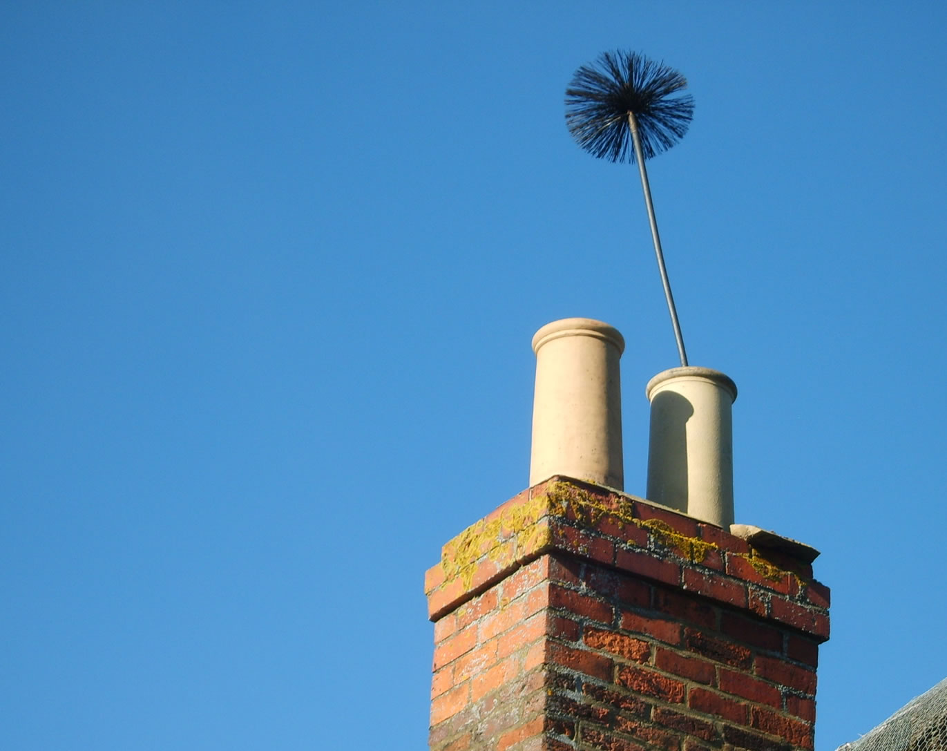 a chimney sweeping brush
