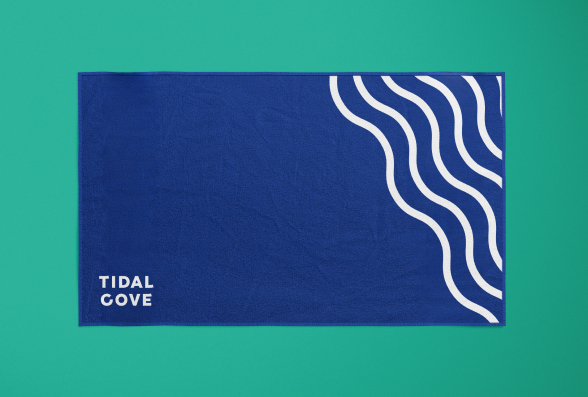 A branded Tidal Cove towel with a graphic design