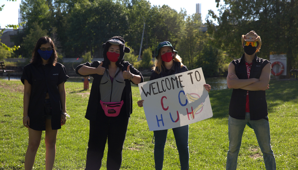 Students in masks promoting clubs at Trent University