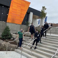 Students wearing masks on the steps of Trent University Durham GTA.