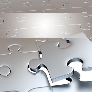Silver puzzle pieces