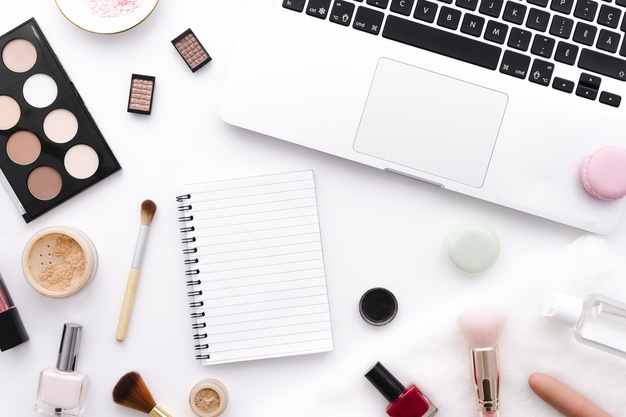 Free Photo | Top view make up with notebook and laptop