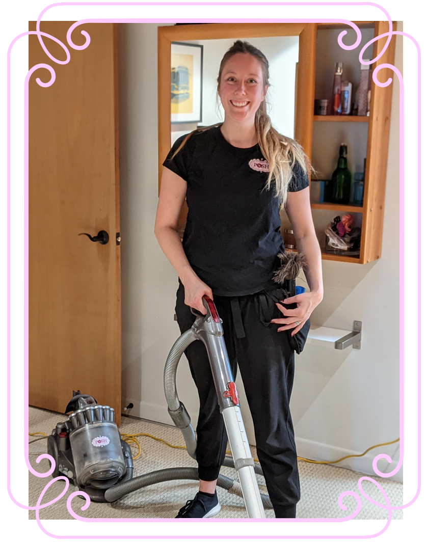 POSH Cleaning Services - Woman cleaning with a vaccuum