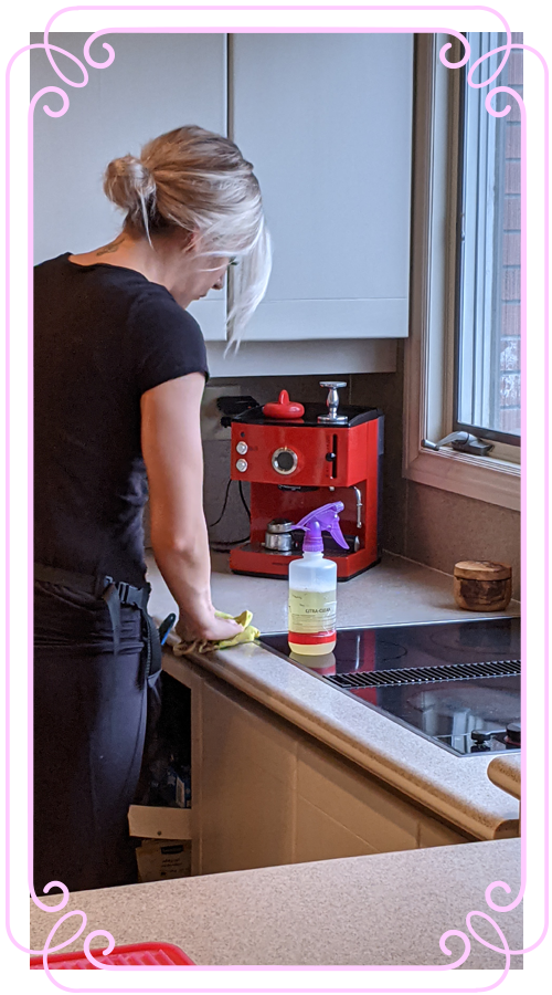 POSH Cleaning Service   POSH Maid Service - Woman cleaning kitchen area