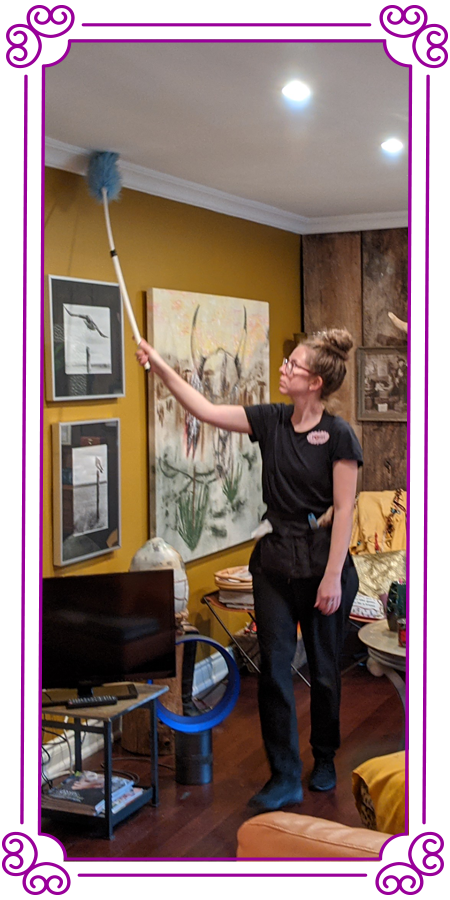 POSH Cleaning Services | POSH Maid Service - Woman cleaning the ceiling using a duster on a pole in a large room