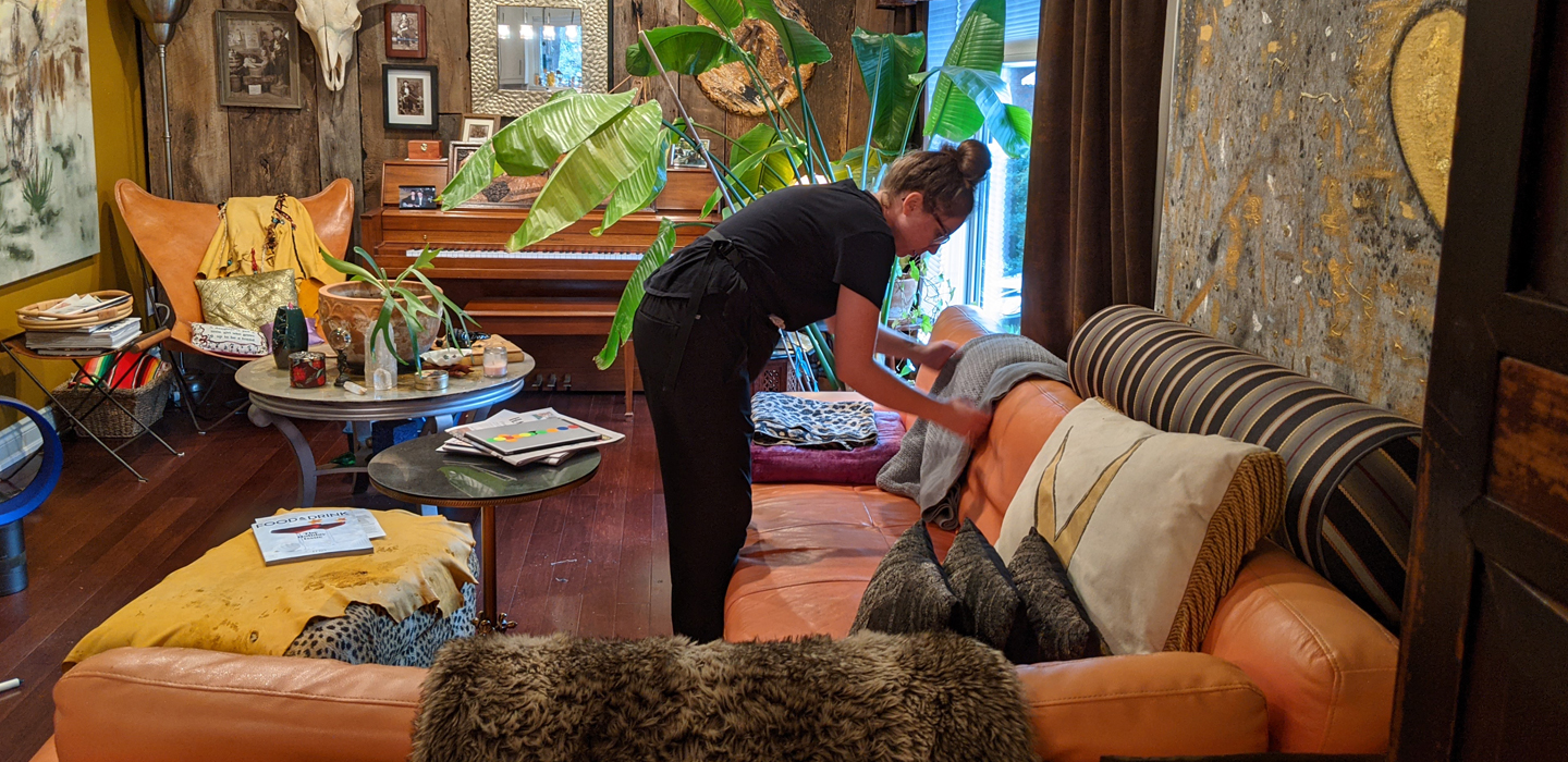 POSH Cleaning Services | POSH Maid Services- POSHployees Staff Cleaning in a living room