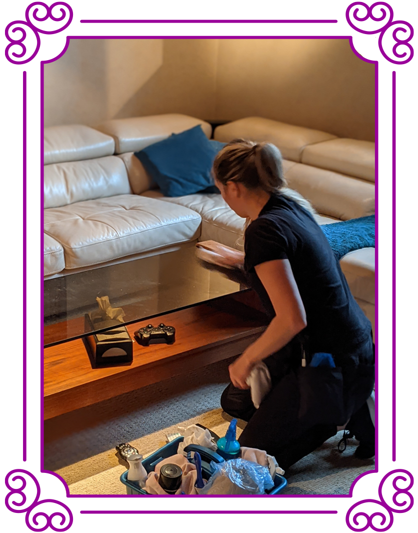 POSH Cleaning Service | POSH Maid Service - Woman cleaning a table