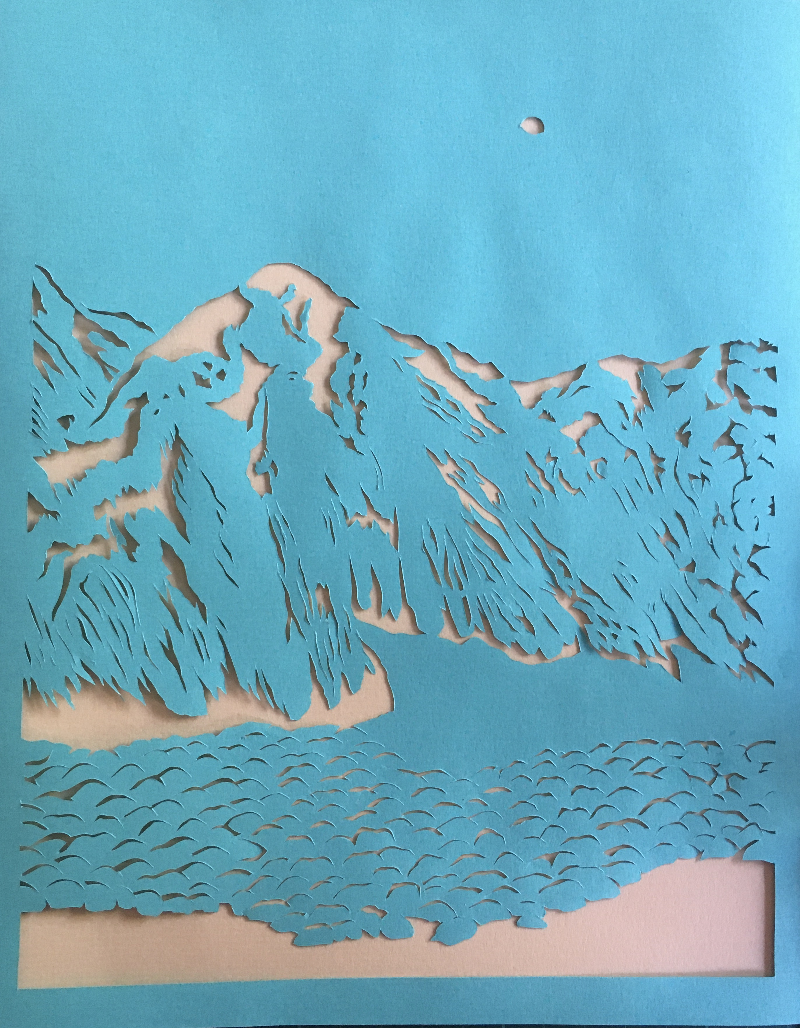 cliff scene created by cutting details out of one piece of paper