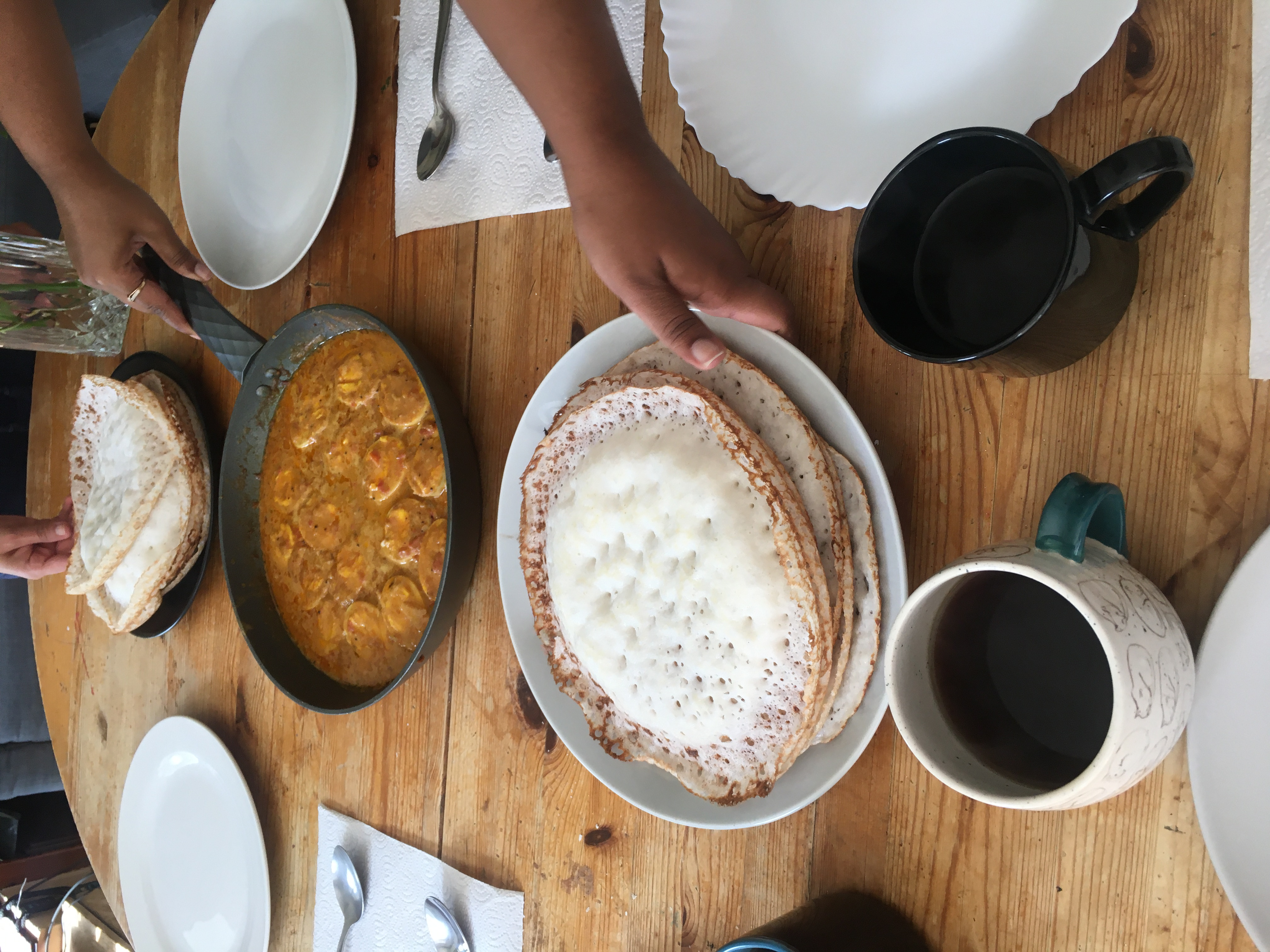 Egg korma and appam - a rice and coconut pancake