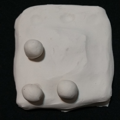 Two puzzle with clay balls and a platform to put the balls ontop of