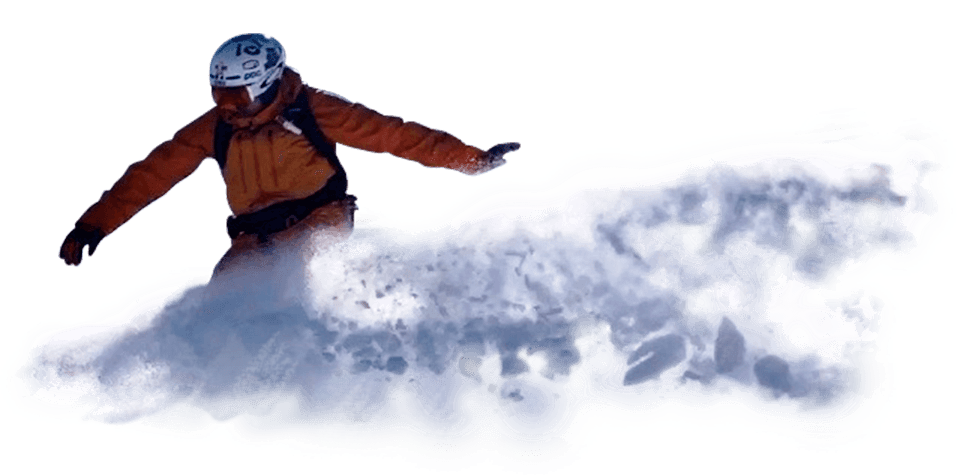 A snowboarder spraying snow.