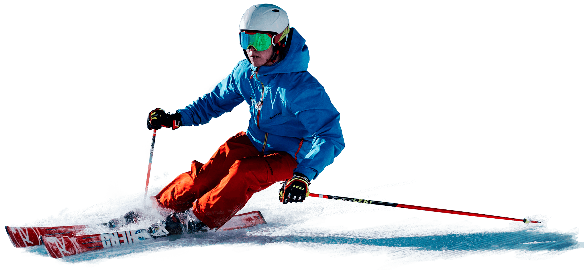 A skier wearing a blue jacket and red pants carves down the piste.
