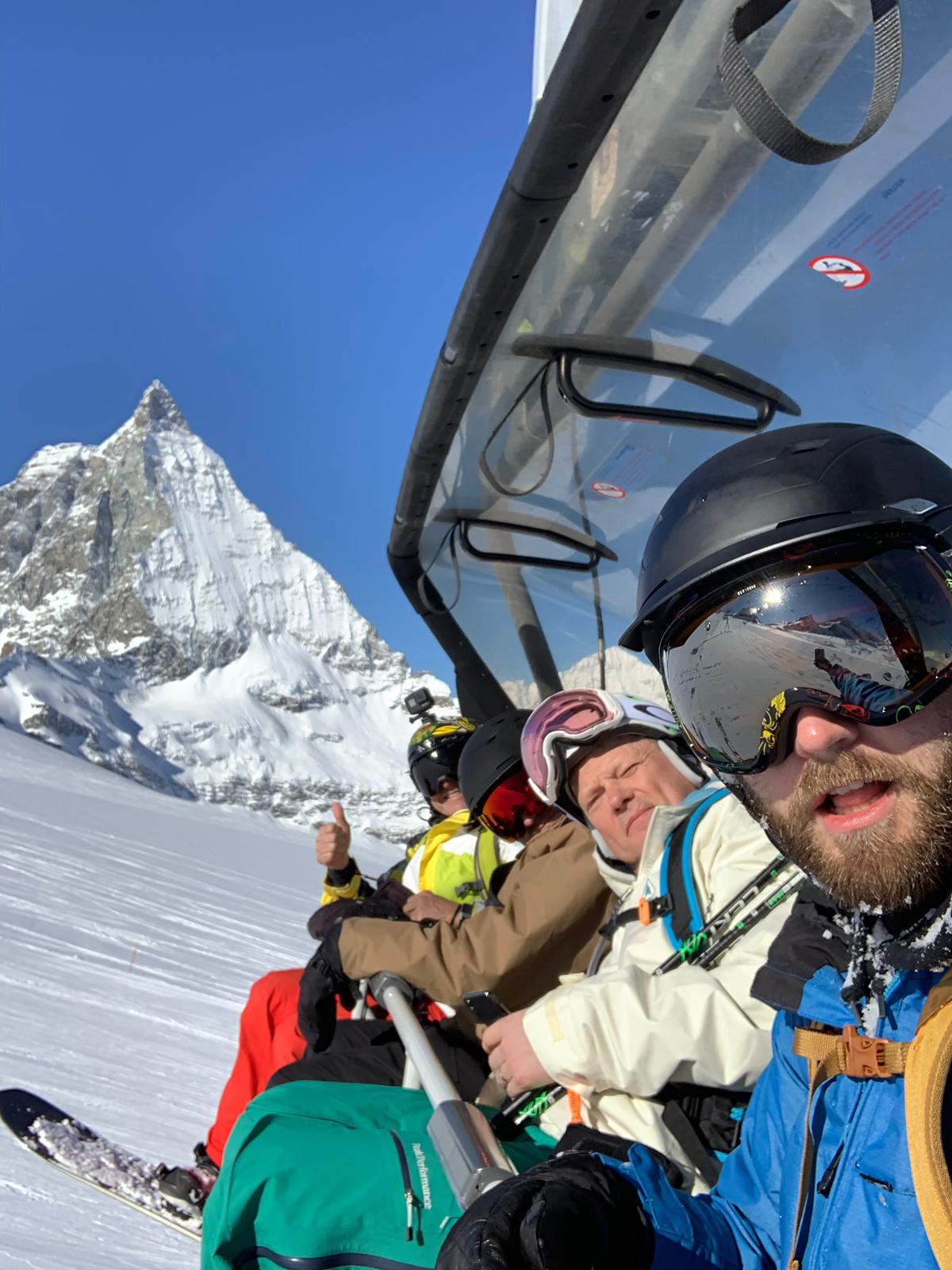A group of FSCers on a chairlift with the Matterhorn in the background.