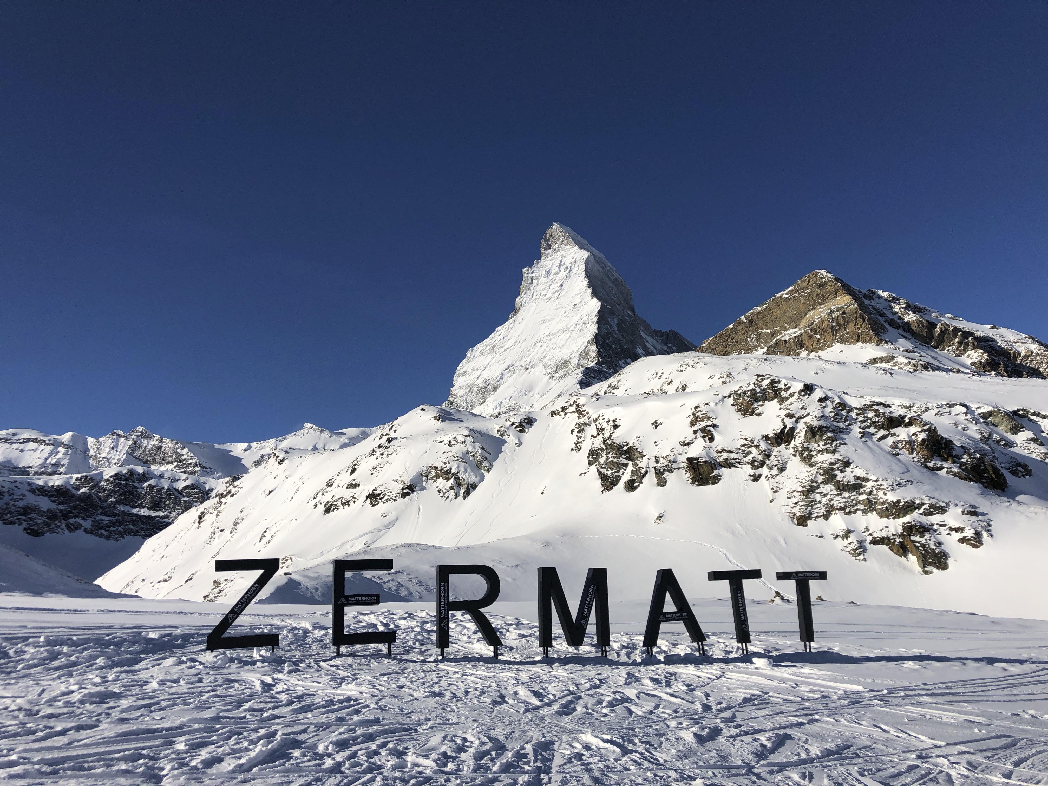 Zermatt sign with the matterhorn in the background.