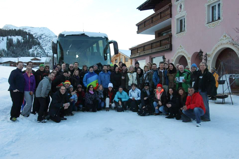 group photo in front of bus