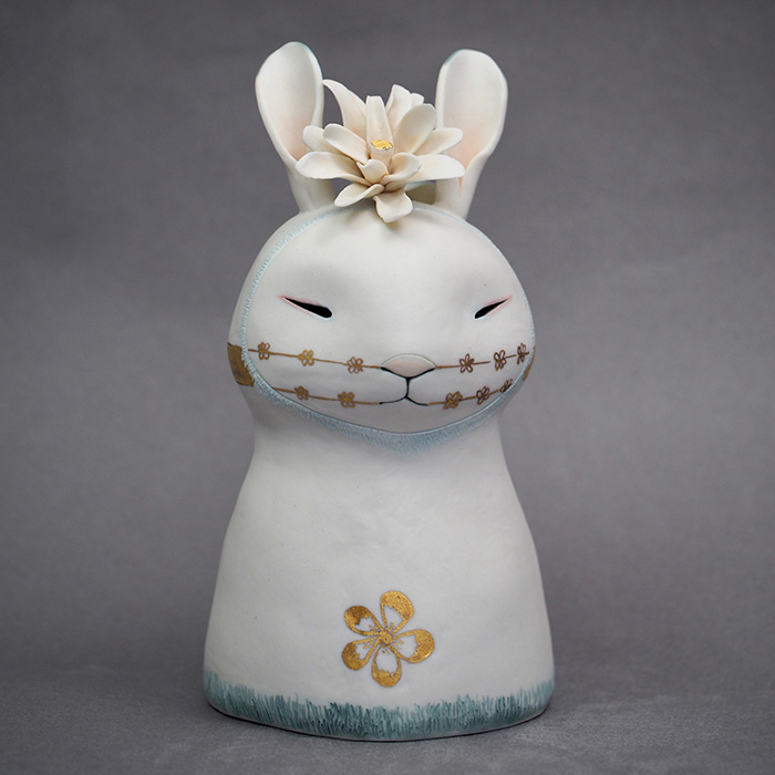 White rabbit speaks with flowers