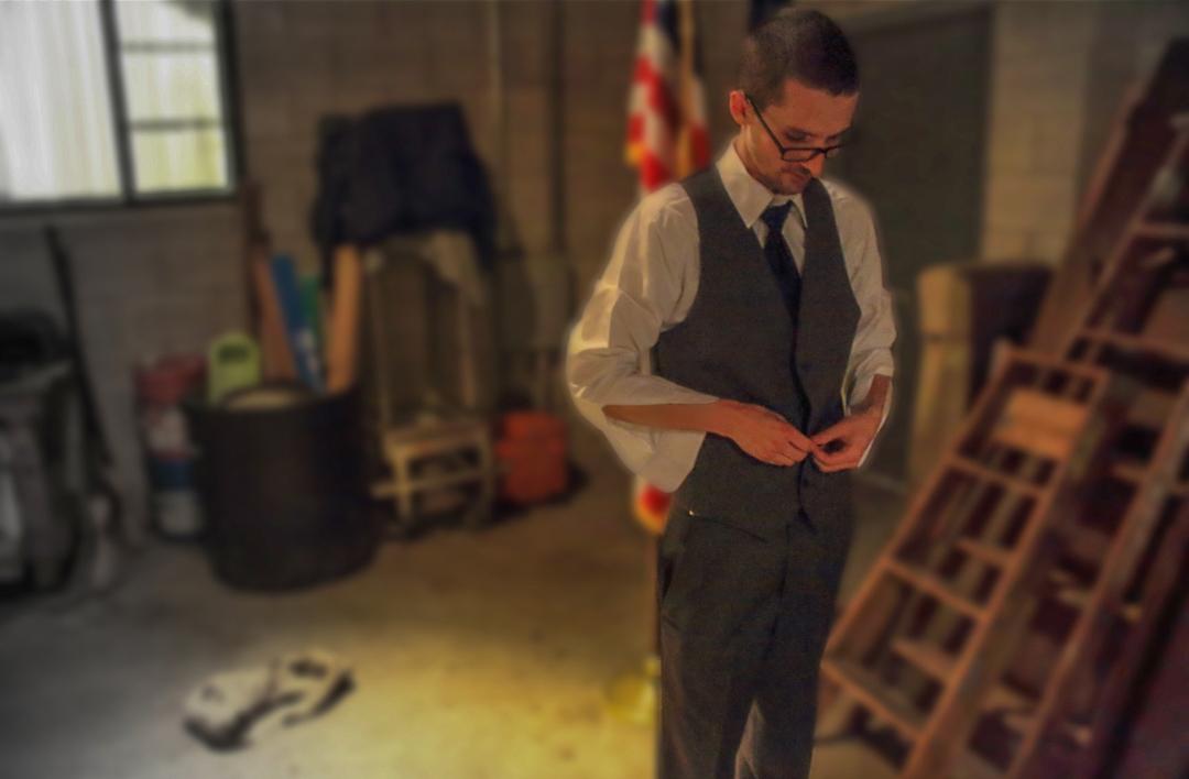 Image of groom adjusting clothing