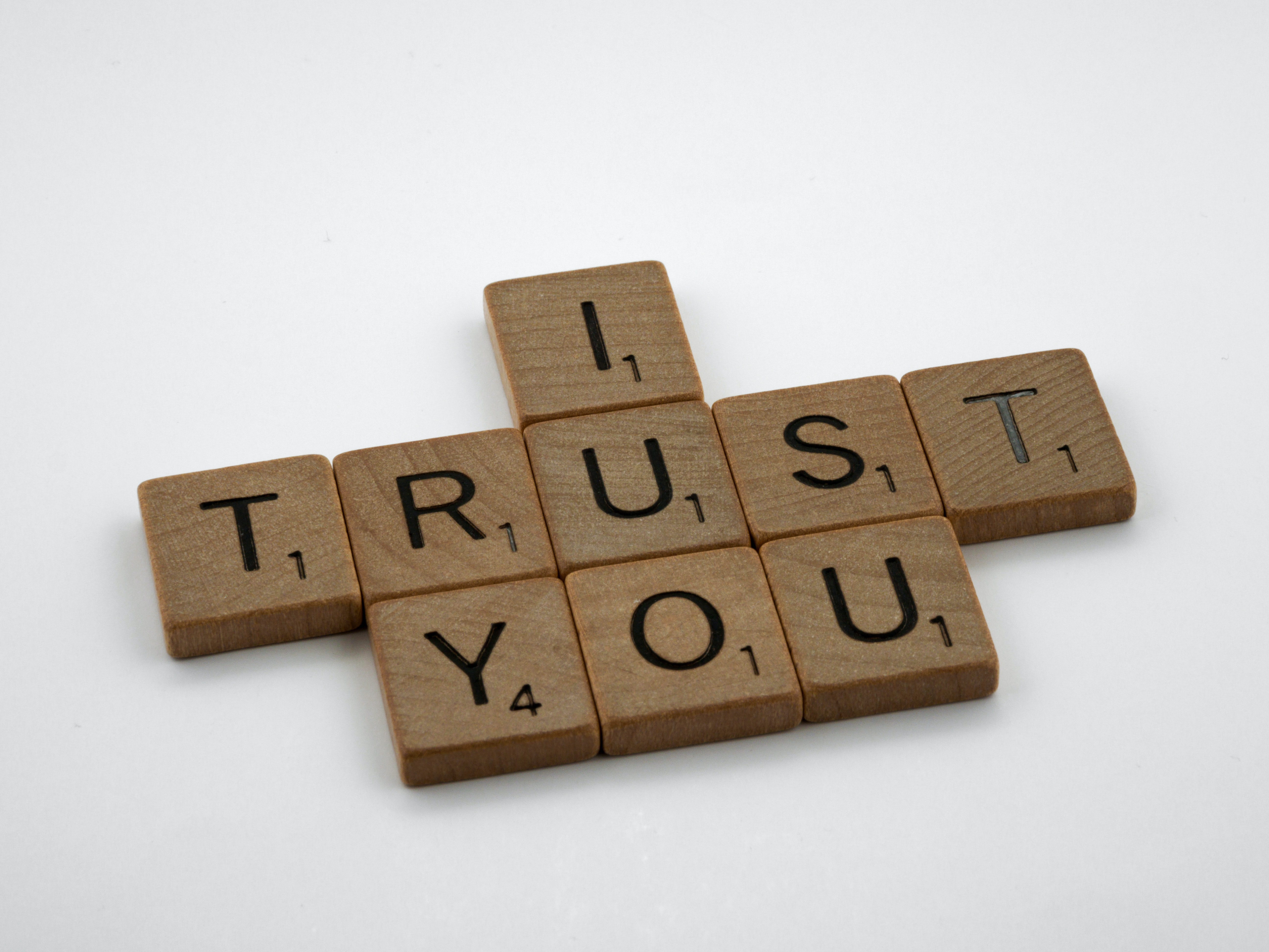 "A set of Scrabble letters reading ""I Trust You."" Remote managers need to trust their teams."