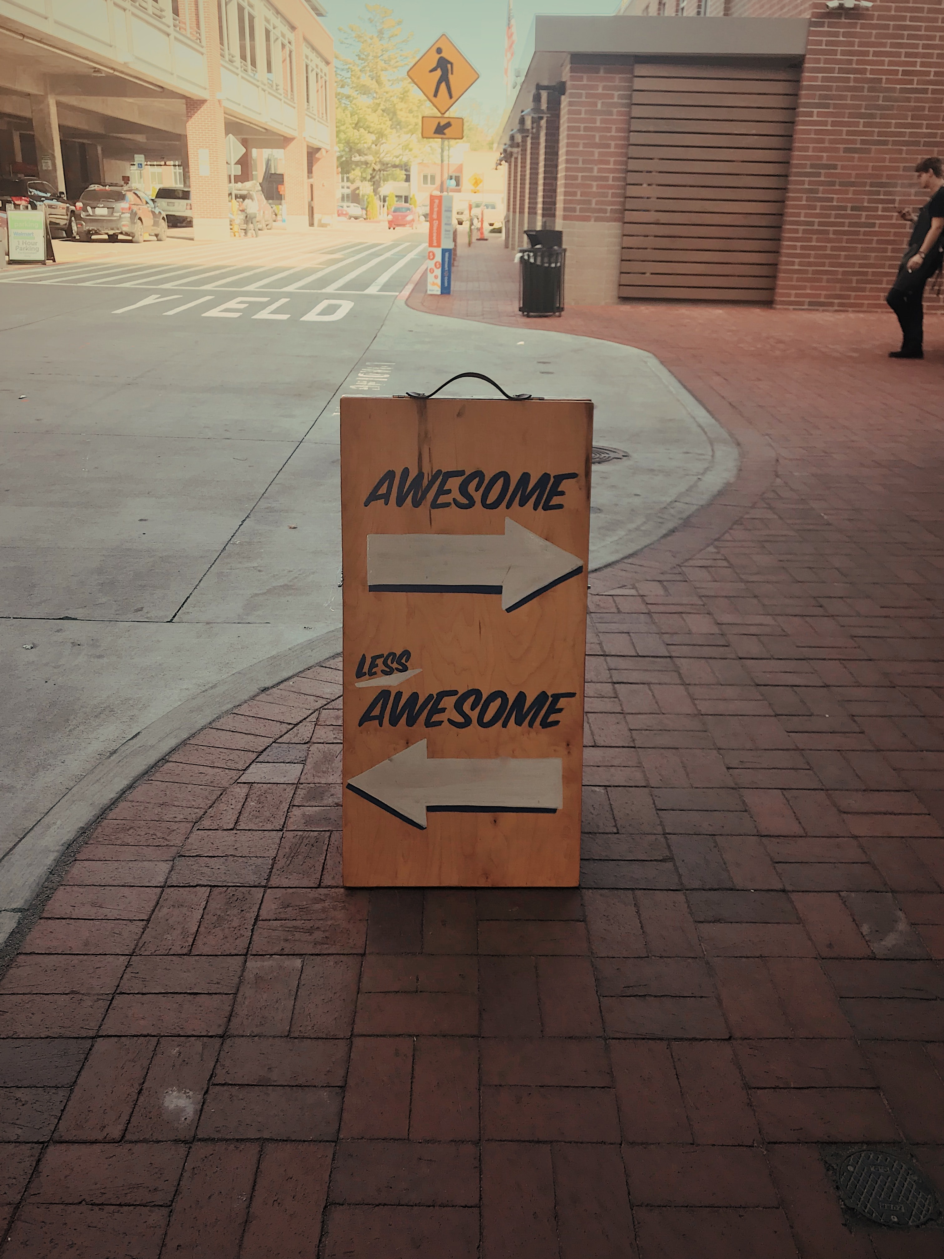 "A sign saying ""awesome"" and ""less awesome."" The best remote managers know how to give and get feedback."