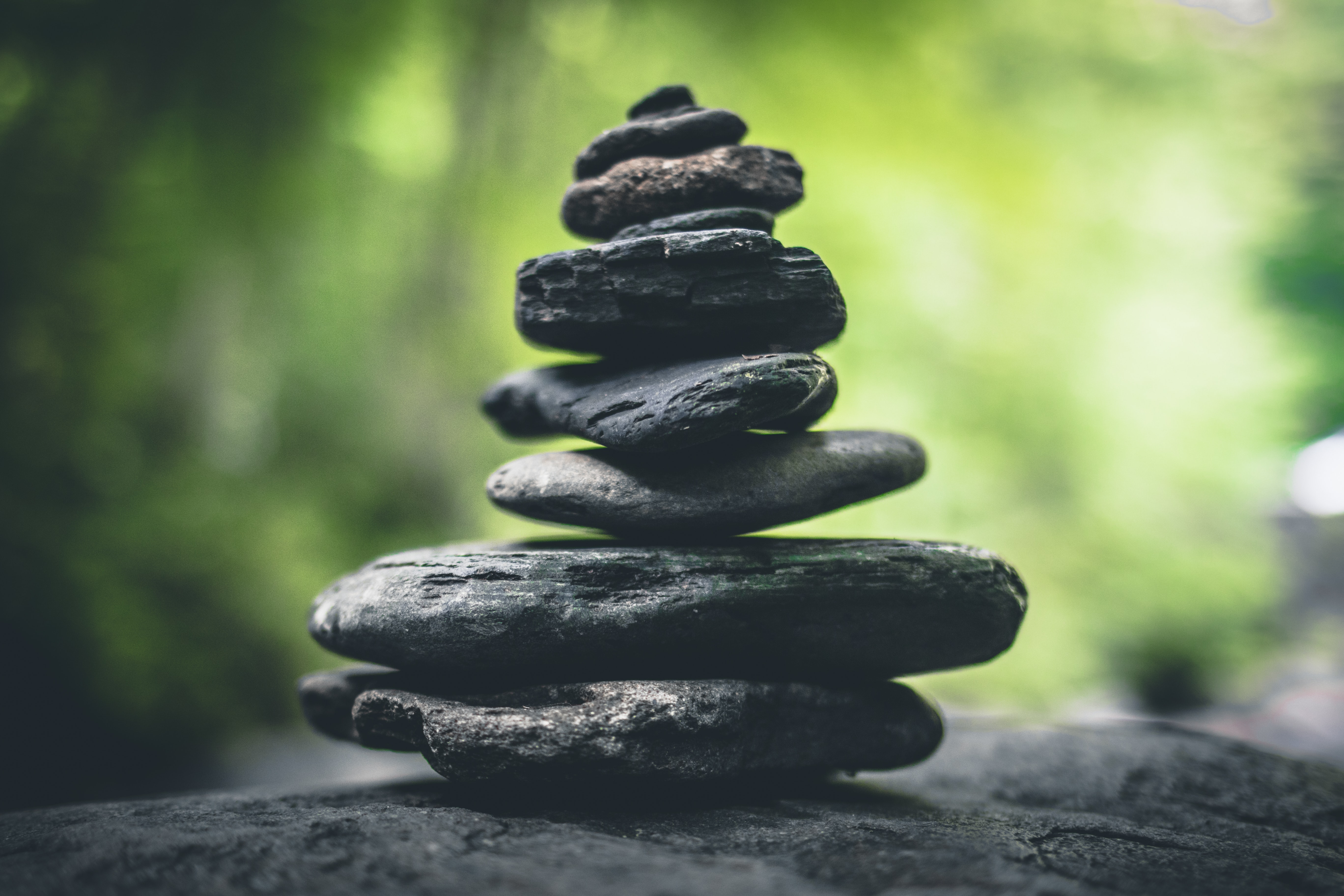 A stack of rocks reflects balance and the importance of value-based remote bonding.