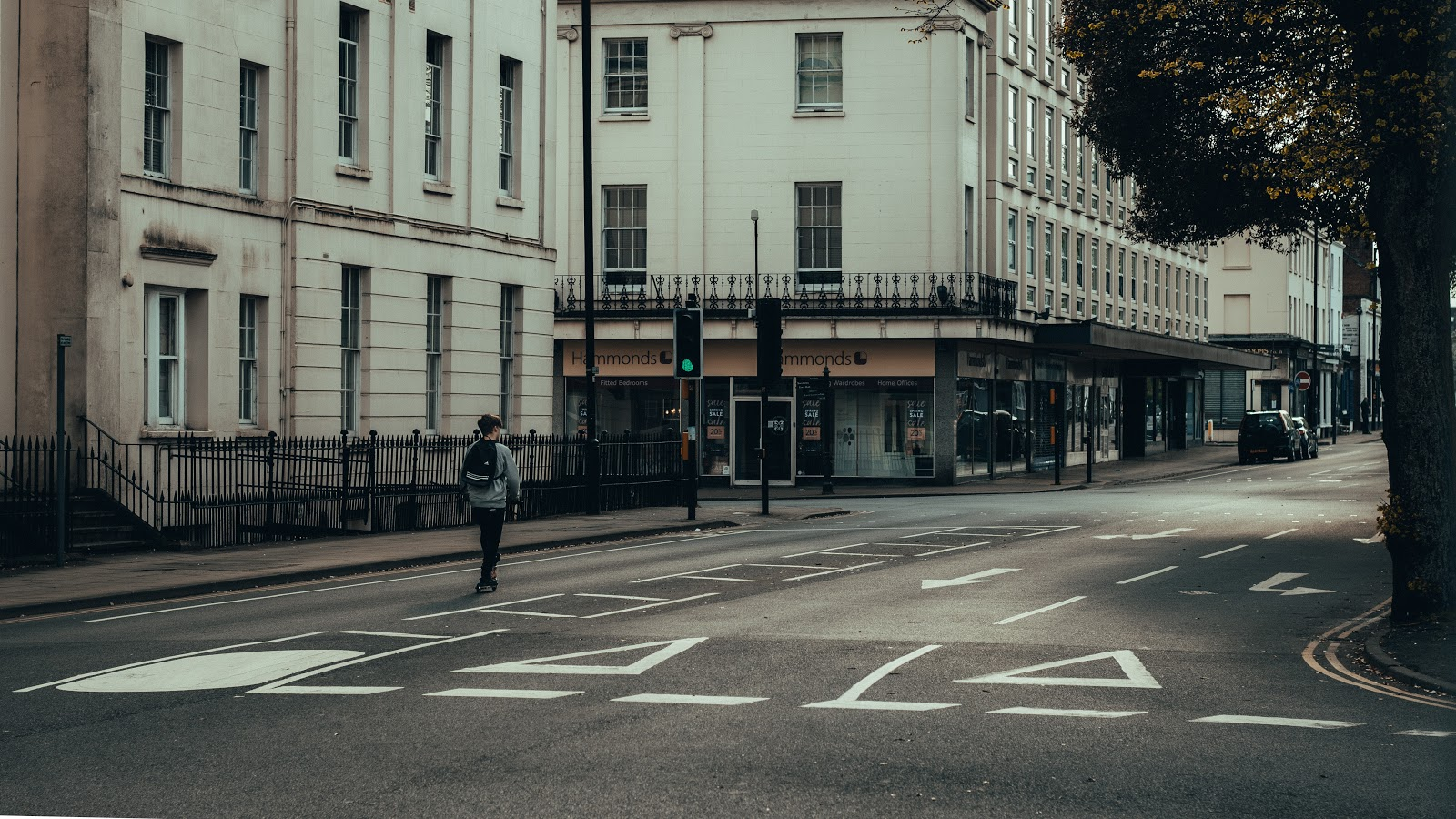Remote teams can be incredibly isolating.This image shows a lone man walking through a city on pandemic lock-down.