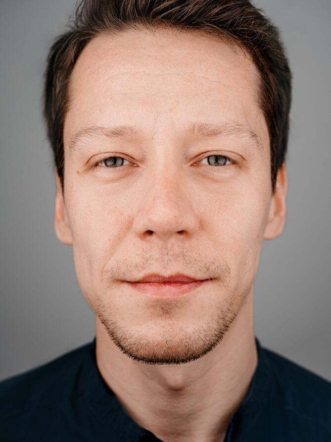 Portrait photo of the team member