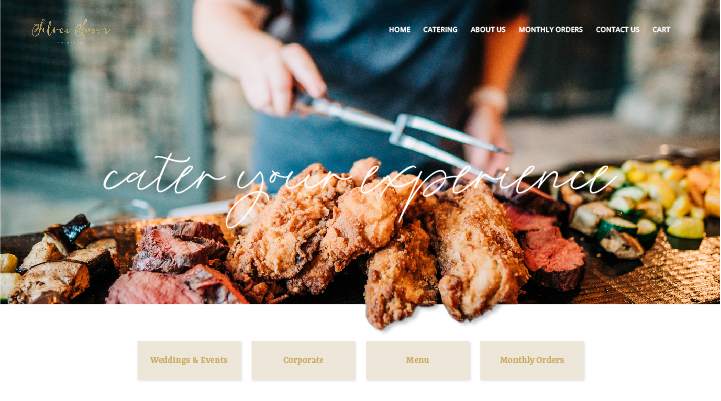 Silver Spoon Catering Home page website layout. Caterer is carefully placing food on wood block of a beautiful display for an event.