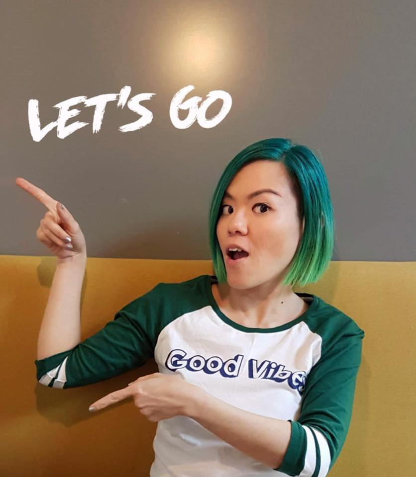 "Penny Soo pointing to the wall that says ""Let's go�"
