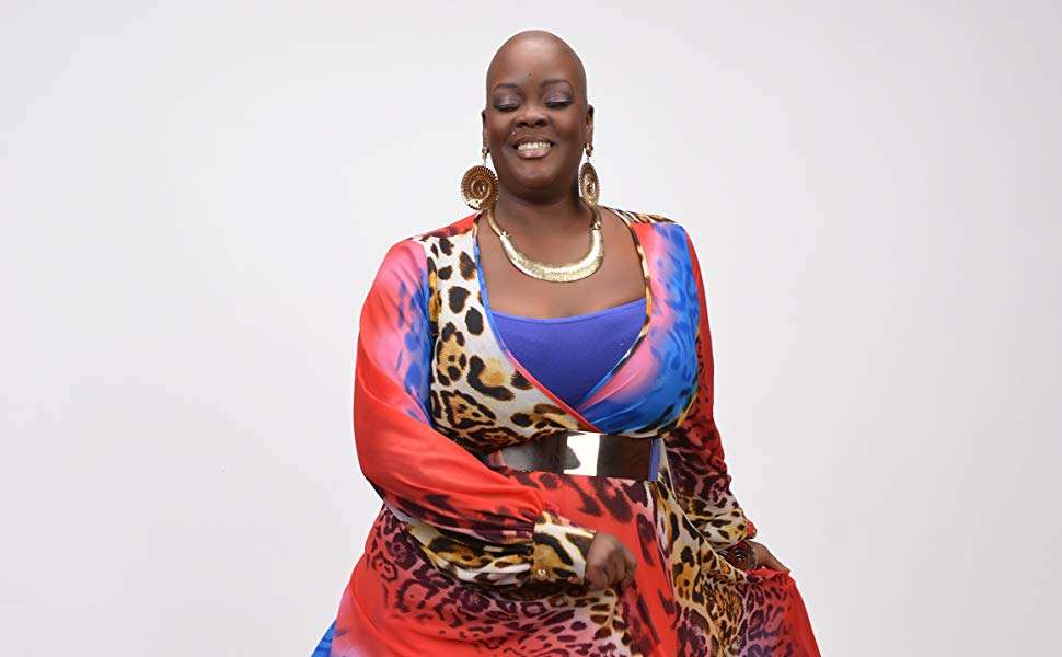 Sonya Renee Taylor in a colourful dress