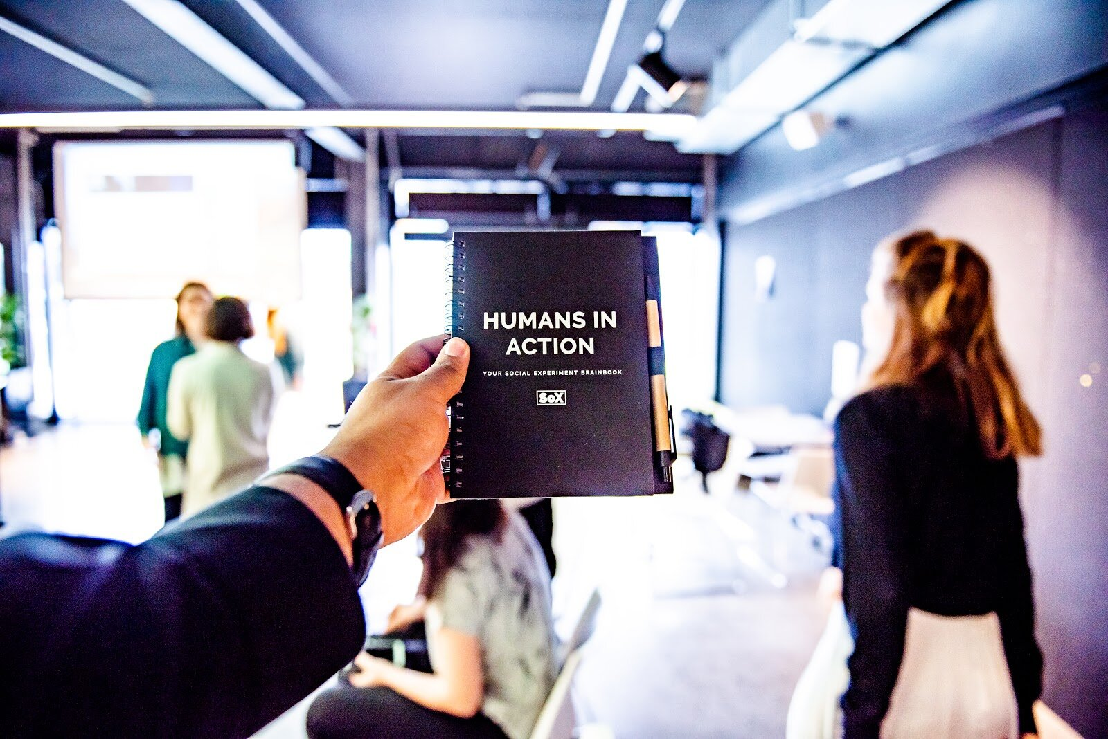"""A notebook from The Social Experiment (SoX) that says: """"Humans in Action�"""