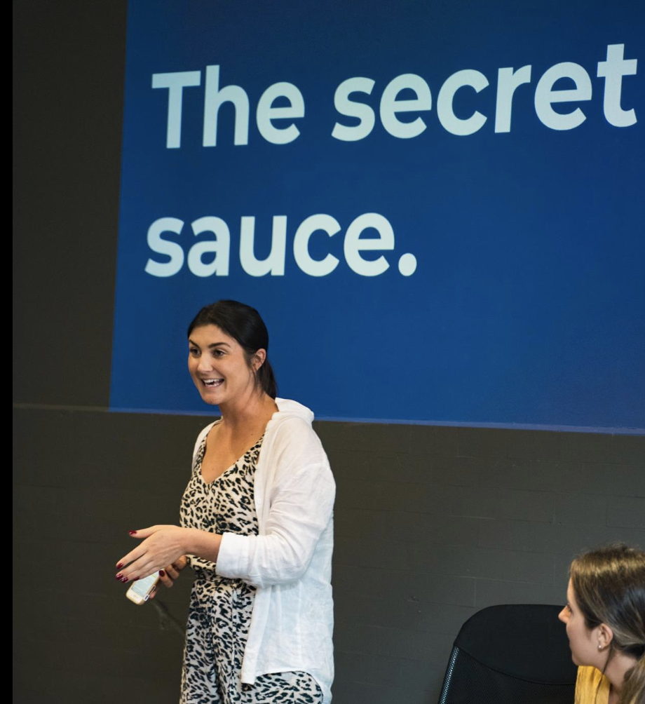 "Briony talking at The Social Experiment, the words: ""The secret sauce.� projected at the back"