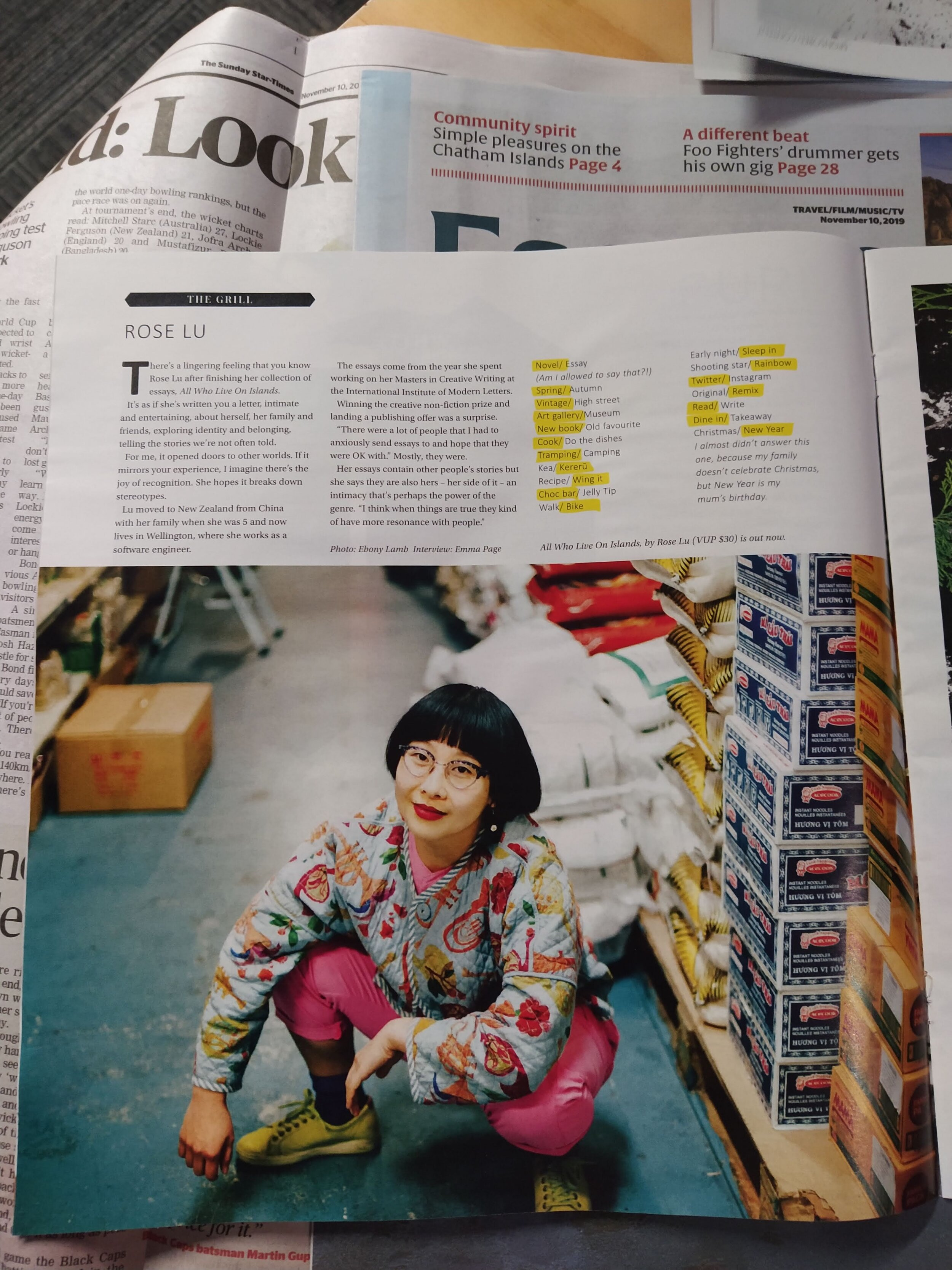 "An article about Rose Lu from the magazine ""The Grill"" with the photo of her kneeling down at the grocery store"