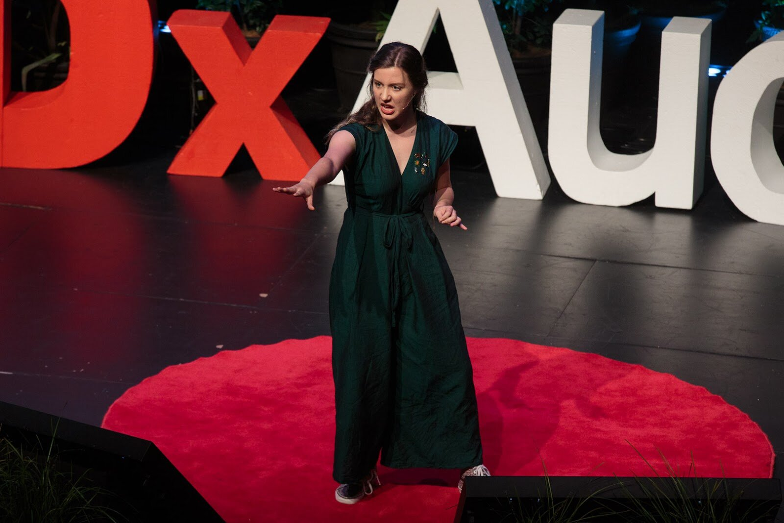 Rose on the TedX Auckland stage doing spoken poetry in a very dedicated stance. Credit for the image to: Connor Crawford
