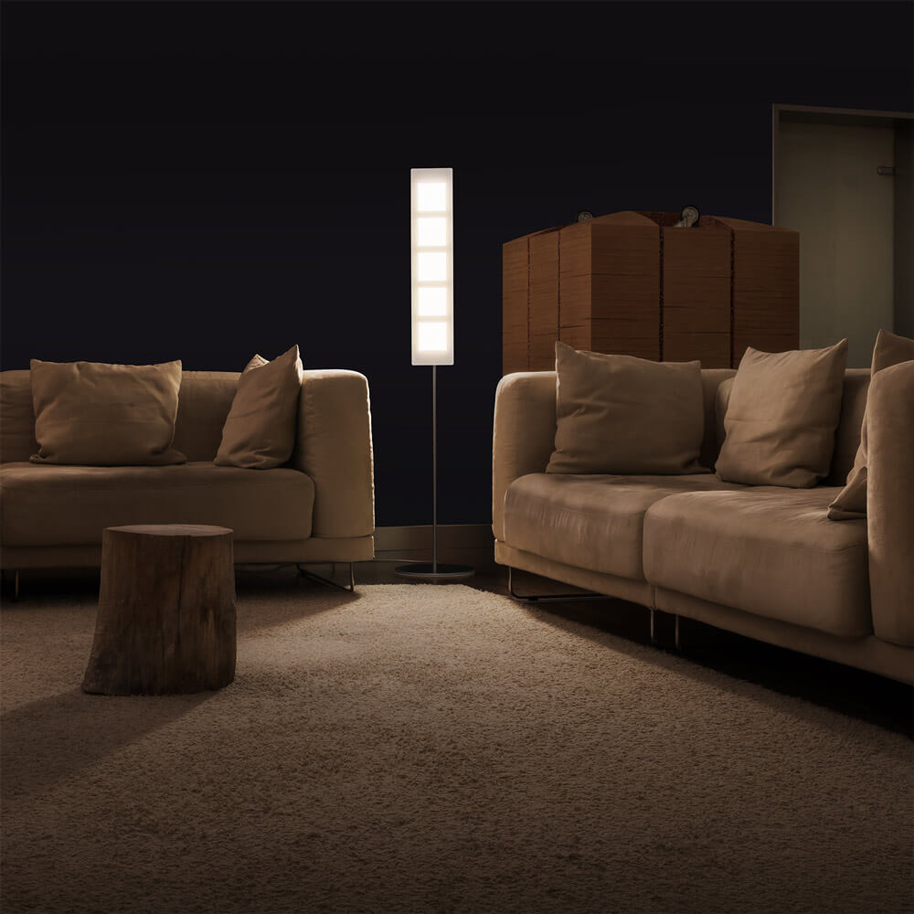 OMLED OLED standing lamp between two sofas