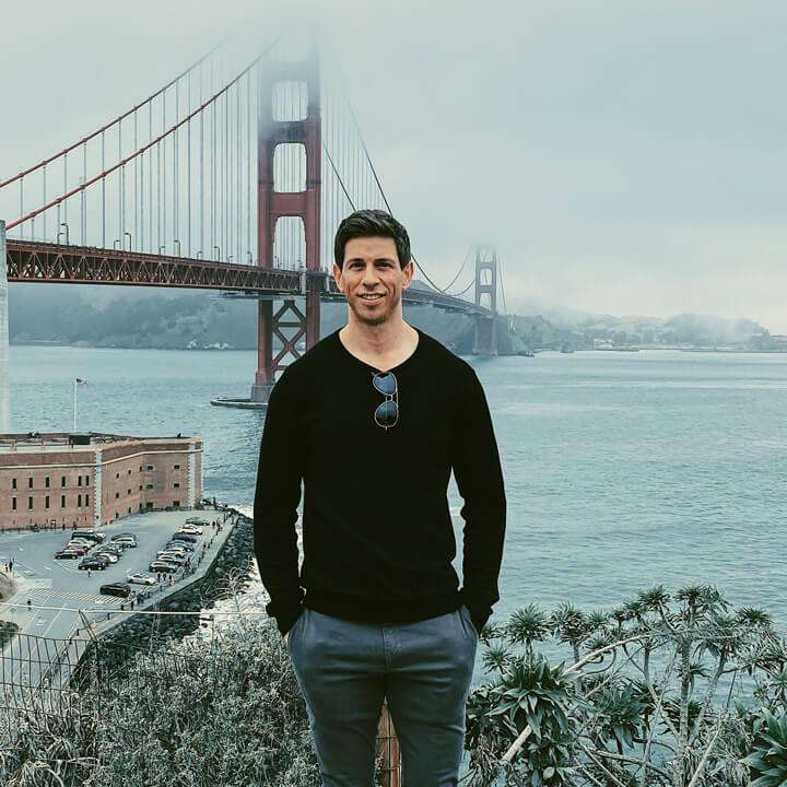 Robbie Crabtree in front of a bridge