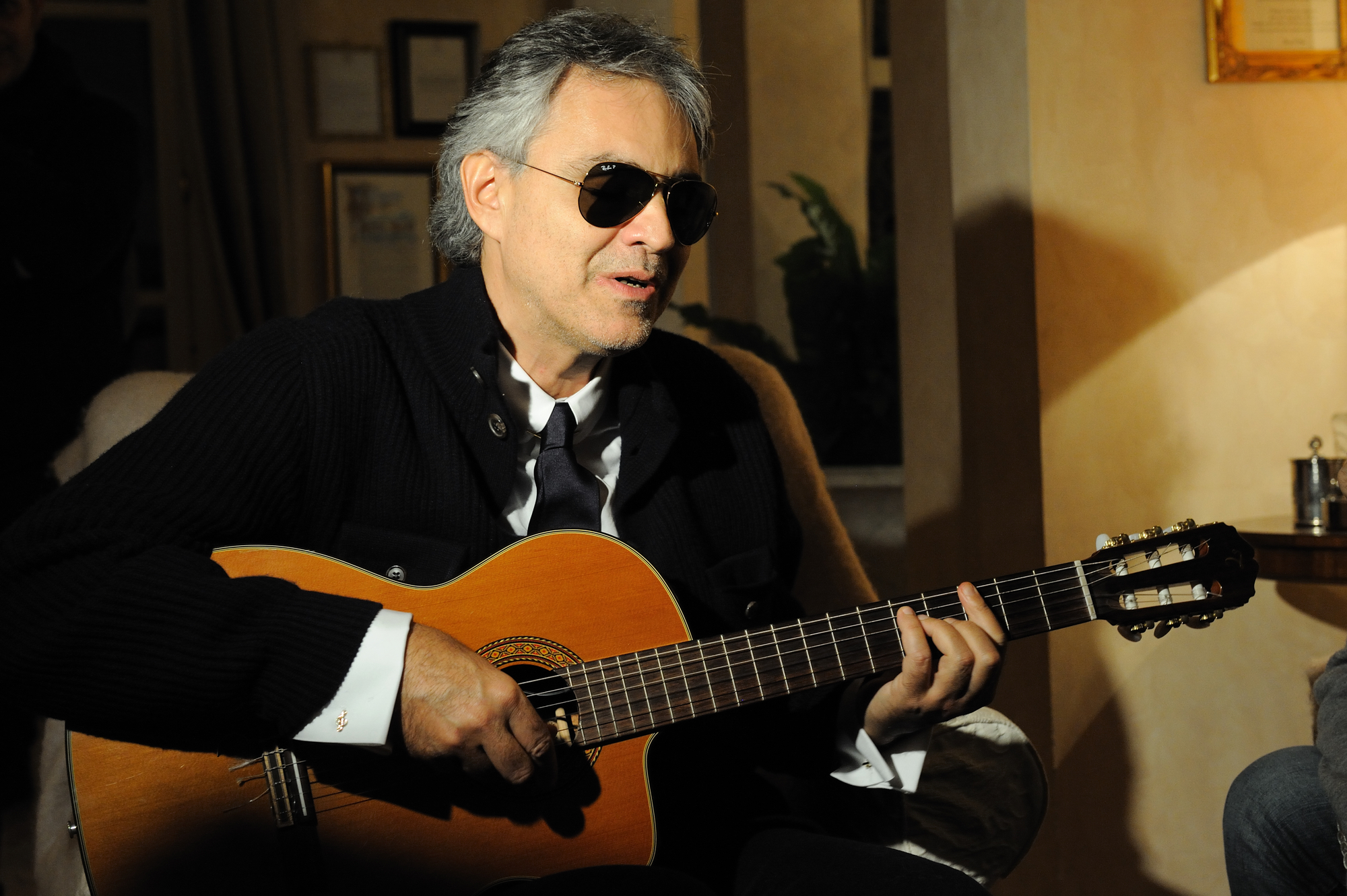 Andrea Bocelli playing a guitar