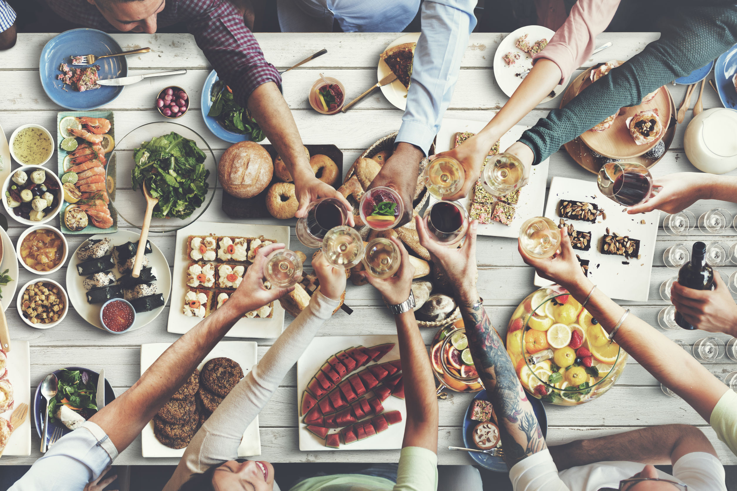 Picture of a group toasting and eating fusion food