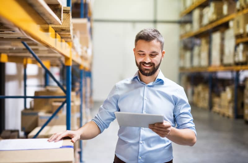 Man Checking Stock With Tablet