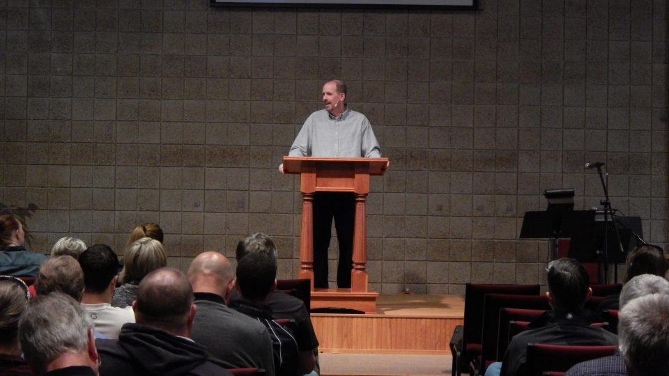 Pastor preaching message from pulpit