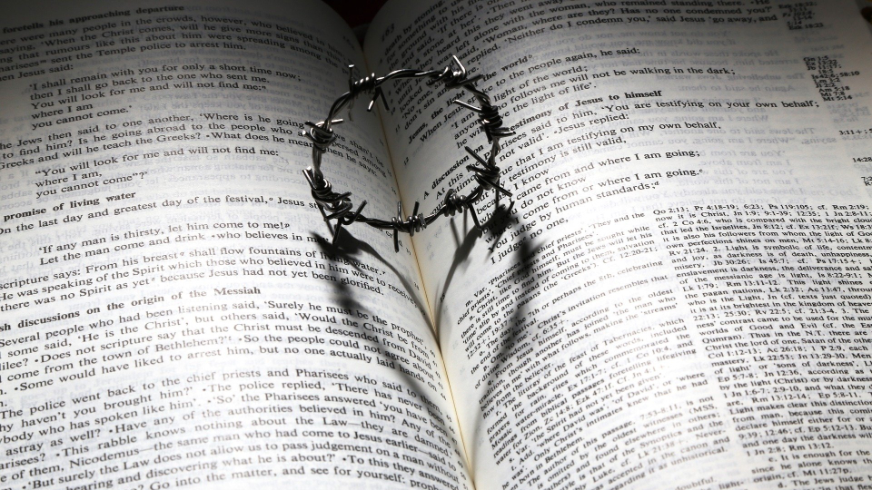 open Bible with crown of thorns